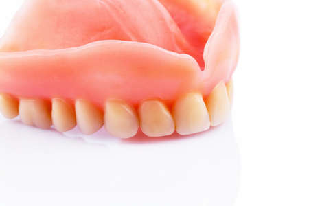 surgery expenses: teeth against white background, symbol photo for dentures, diagnosis, and co-payment