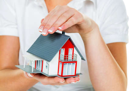 single familiy: a broker for real estate with a house and a key. successful leasing and property for sale by real estate agents.