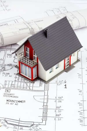 modell: an architects blueprint with euro money. symbolic photo for funding and planning of a new house. Stock Photo