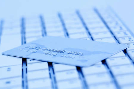 close-up a credit card for cashless pay and keyboard. symbolic photo for shopping on the internet. Stock Photo