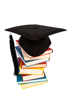 a graduation hat on a book stack photo