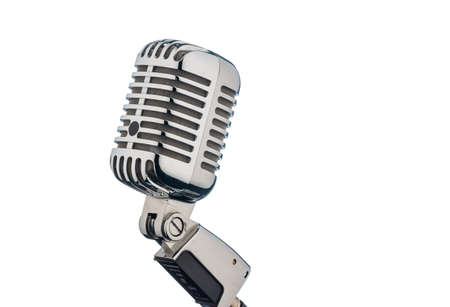 occurs: an old retro microphone against white background.