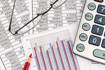 vat: a calculator is on a balance sheet figures statistics Stock Photo