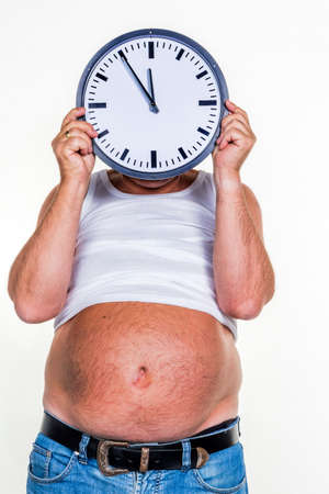 man with overweight hold a clock photo