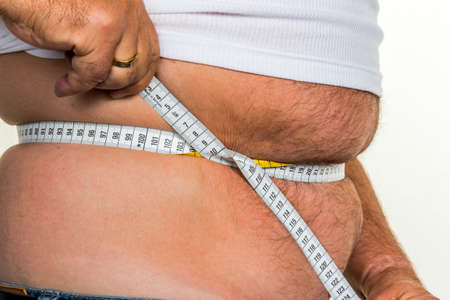 man with overweight with measurement tape photo