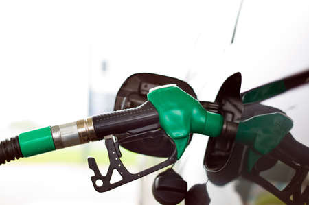 ecodiesel: a tap for gasoline at a gas station. refueling a car