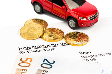 modell: a settlement of travel expenses by car and euro coins Stock Photo