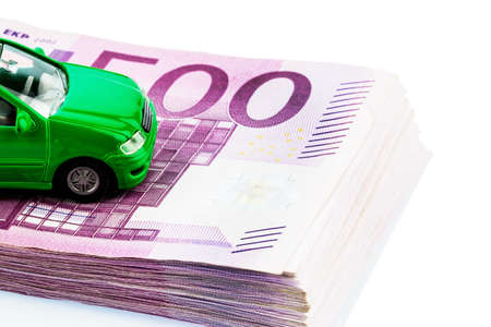 fully comprehensive: green model car on banknotes, symbolic photo for car buying, financing and costs
