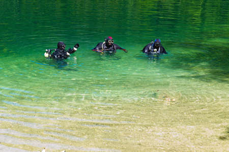 freetime: in a sea divers are ready to make a dive. austria, upper austria, langbathsee. Stock Photo