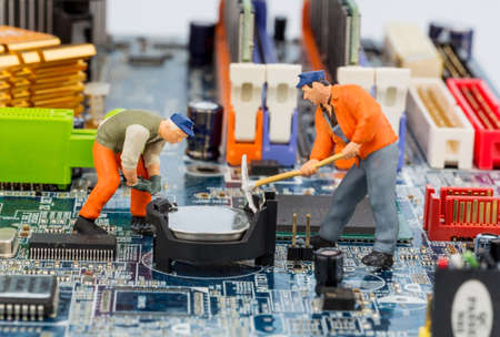 computer board and workers, symbol photo for computer failure, maintenance, data security photo