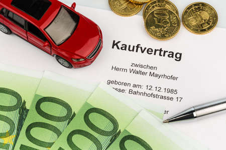 a purchase contract to buy a car at the car dealer. new and used cars Stock Photo
