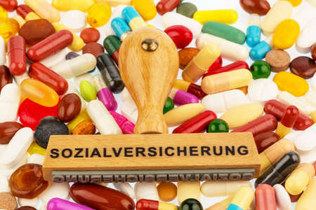 reimbursement: stamp on colorful tablets, symbolfot for social security, drugs and reimbursement