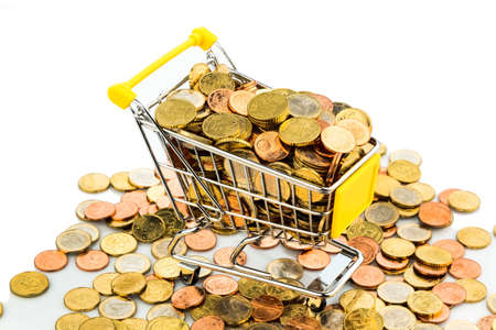 consumerist: a shopping cart is well stocked with euro coins, symbolic photo for purchasing power and consumption Stock Photo