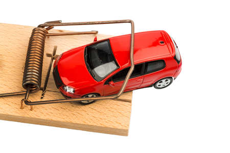 a model car in a mousetrap, symbolic photo for car expenses and debts Stock Photo