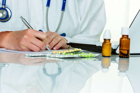 physicans: a doctor issues a prescription for medication. prescription tablets from the pharmacy. Stock Photo