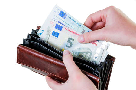 subsistence: in a wallet, there are some euro banknotes. running short of money by the new poverty. Stock Photo