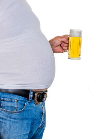 man with overweight. symbolic photo for beer belly, unsuccessful diets and poor diet. photo