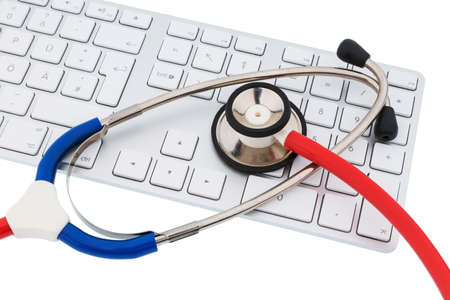 physicans: stethoscope and keyboard of a computer, symbol photo for diagnosis and appointment management