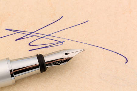 notieren: a contract or document is signed by hand with a fountain pen.