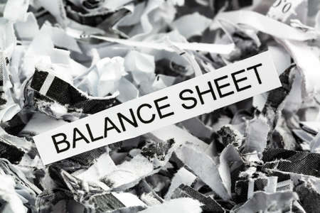 auditors: shredded paper tagged with balance sheet, symbol photo for data destruction, budgets and accounting