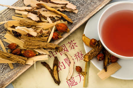 ingredients for a cup of tea in traditional chinese medicine. cure of diseases by alternative methods. photo