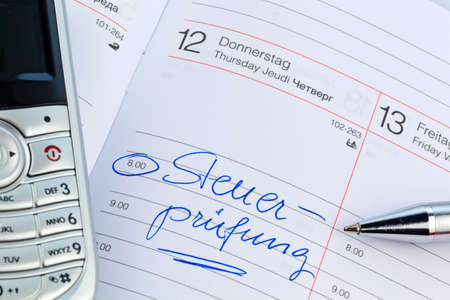 auditors: a date is entered on a calendar: tax audit