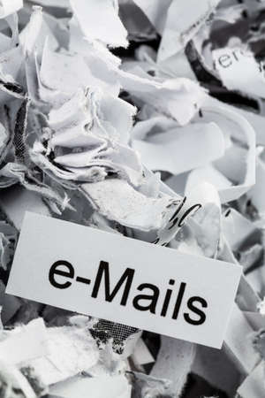 tagged: shredded paper tagged with e-mails, symbol photo for data destruction, mails and data flooding Stock Photo