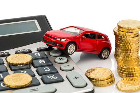 car and calculator. rising costs for buying a car, leasing, workshop, refueling and insurance photo