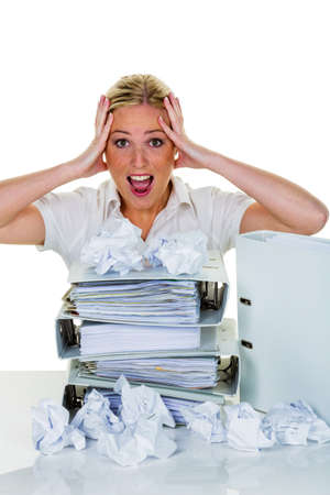postpone: young woman in office is overwhelmed with work. burnout in work or study.