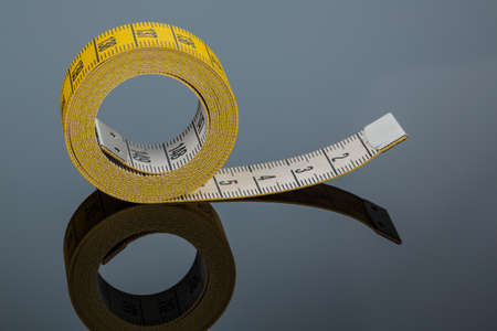 yellow tape measure, symbolic photo for diet control and precision photo