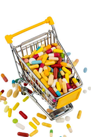 healthcare costs: colorful tablets in the shopping cart icon photo for healthcare costs, pharmacies, abundance of drugs