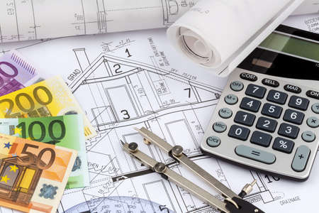an architects blueprint with a calculator and euro money. symbolic photo for funding and planning of a new house. photo