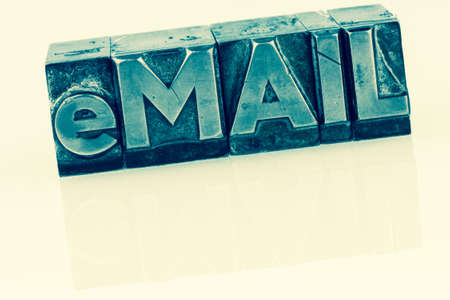 the word e-mail in lead letters written. symbolic photo for quick correspondence photo
