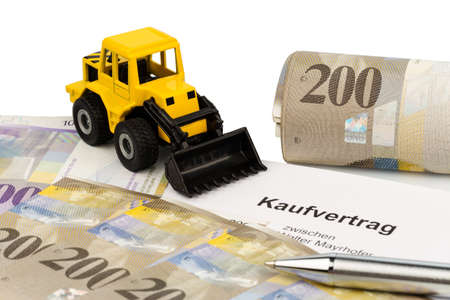 a purchase contract for new excavator. investing in new vehicles brings cost advantages. with swiss francs photo