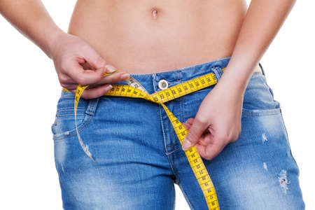 thinness: a young woman with a tape measure before the next diet. losing weight and fast