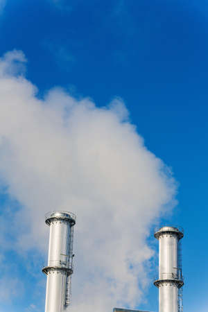 ozone: chimney of an industrial company a wake smoke. symbolic photo for environmental protection and ozone.