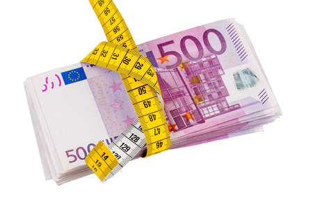 budgetary: notes and tape measure, symbolic photo for austerity measures, fiscal consolidation and controlling Stock Photo