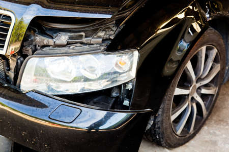 a car with body damage after an accident in a car workshop