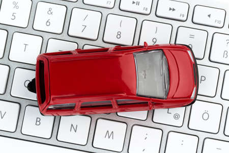 car on keyboard, symbol photo for car buying and trading cars on the internet photo