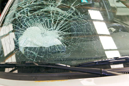 a broken windshield and an air bag during an accident car ausglöster Stock Photo