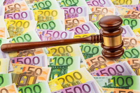 judge gavel and euro banknotes. symbolic photo for costs in court of law and auctions Stock Photo
