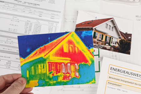 heat radiation: saving energy through thermal insulation. house with thermal imaging camera photographed. Stock Photo