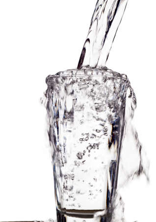 dehydrate: pure and clean water is filled into a glass. drinking water, water glass, glass, dehydration, dehydrate, dehydration in a teacup.