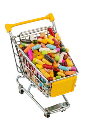 consumerist: tablets with shopping cart. symbolic photo for the purchase of medicines on the internet Stock Photo
