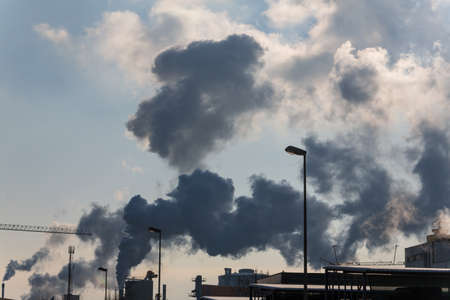 ozone: chimney of an industrial company with smoke. symbolic photo for environmental protection and ozone.