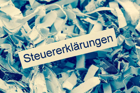 tagged: shredded paper tagged with tax returns, symbol photo for tax burden and retention requirements