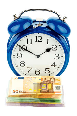 collective bargaining: an alarm clock and banknotes, symbolic photo for wage costs, labor costs, time work Stock Photo