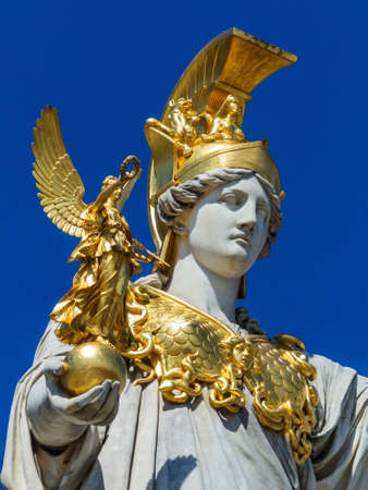 pallas: the parliament in vienna, austria. with the statue of pallas athene the greek goddess of wisdom. Stock Photo