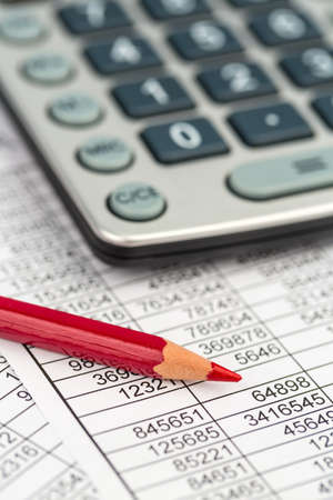 turnover: a calculator is on a balance sheet numbers are statistics.
