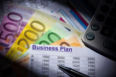 reestablishment: a business plan for starting a business. ideas and strategies for business creation. euro banknotes and calculator